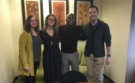 Washington Filmworks Accounting Assistant Amanda England, Executive Assistant Ashley Fendler, and Communications Coordinator Andrew Espe with Brick Lane Records' Kirt Debique (center)